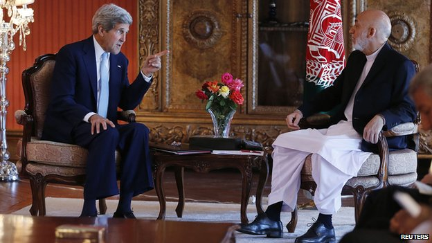 "U.S. Secretary of State John Kerry meets with Afghanistan""s incumbent President Hamid Karzai (R) at the presidential palace in Kabul July 11,"