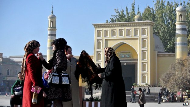 This picture taken on 8 November 2013 shows a group of Uighur women outside a mosque in Kashgar, far west China's Xinjiang region.