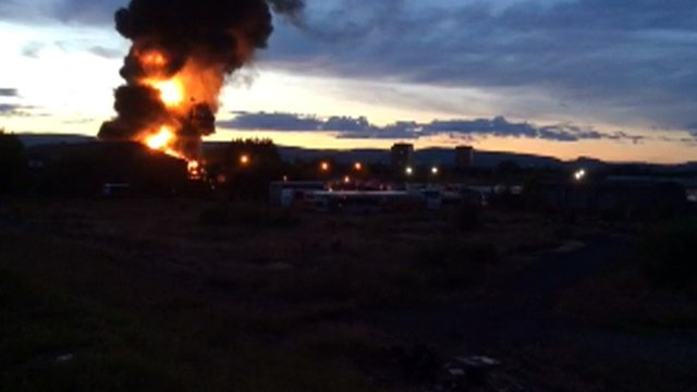 Fire burns at a tyre recycling yard