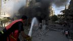 Palestinian firemen try to douse flames