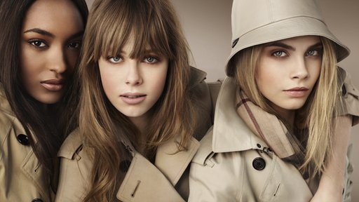 Models wearing Burberry trench-coats