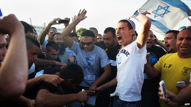 Right-wing Israelis shout slogans during an anti-Palestinian demonstration at the Gush Etzion junction, a settlement next to the biblical Palestinian town of Bethlehem on 16 June 2014