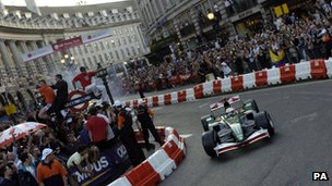 Racing veteran Martin Brundle driving a Jaguar along Regent Street