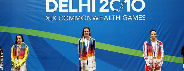 Hannah Miley stands on the podium after her triumph at the Delhi 2010 Commonwealth Games