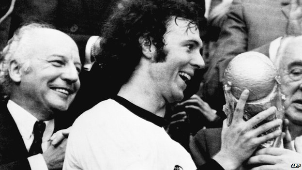 Germany football star and team captain Franz Beckenbauer receives the World Football Cup won by his team after a 2-1 victory over Holland at Munich's Olympic stadium on 7 July 1974