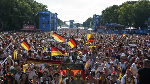 German fans watch the 2014 World Cup quarter-final football match between Germany and France, at the Fanmeile public viewing arena in Berlin on 4 July 2014.
