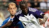 TNS defender Steve Evans tussles for the ball with Romelu Lukaku against Anderlecht, August 2010