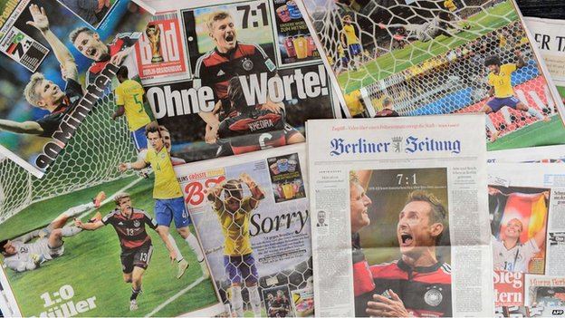 Front pages of German newspapers showing photos from the FIFA World Cup 2014 semi-final football match between Germany and Brazil on July 9, 2014 in Berlin.