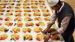A Muslim man prepares food for the daily breaking of the fast