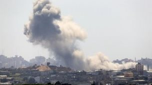 Smoke rises following an Israeli strike on Gaza, seen from the Israel-Gaza border, Friday, July 11, 2014
