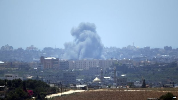 Smoke rises following an Israeli strike on Gaza, seen from the Israel-Gaza border, Friday, July 2014
