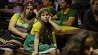 Brazilians of German descent watch Brazil lose 7-1 to Germany at a World Cup semi-final match on TV in Blumenau, Brazil, Tuesday, July 8, 2014.