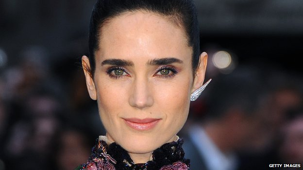 Actress Jennifer Connelly smiles for the press before a film premiere in London