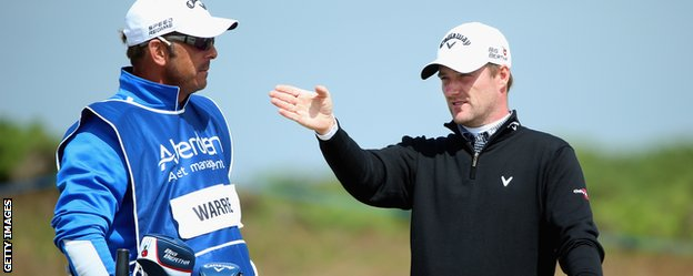 Marc Warren with his caddie on the 18th hole at Royal Aberdeen
