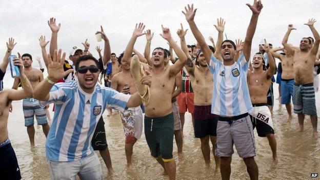 Argentina soccer fans on Copacabana beach in Rio de Janeiro, Brazil, 11 July 2014