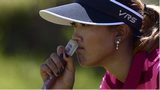 Michelle Wie looks pensive on her way missing the cut in the British Open