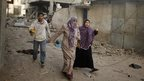Palestinians flee their houses after a reported Israeli air strike on a house in the northern Gaza Strip July 12, 2014.
