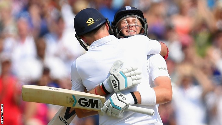 England's Joe Root celebrates his century with James Anderson