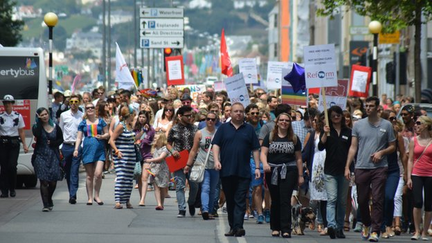 Gay rights protestors march to Liberty Square