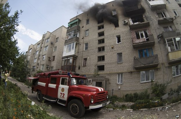 A fire engine outside a damaged block of flats in Marinka, Donetsk, 12 July