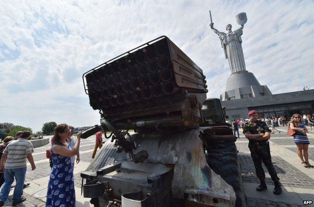 Ukrainian soldiers in Kiev show off a rocket system said to have been captured from the rebels, 12 July
