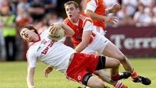 Kieran Toner battles with Colm Cavanagh in the 2012 Ulster SFC game