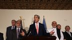 US Secretary of State John Kerry flanked by Abdullah Abdullah and Ashraf Ghani - 12 July