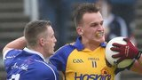 Cavan's Joshua Hayes tries to tackle Roscommon's Enda Smith
