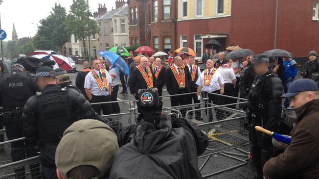 Security barriers are being installed by police in north Belfast ahead of the return leg of a feeder parade