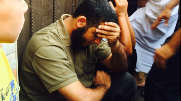 The brother of Hamas fighter Nidal al-Malesh sitting in shock not long after his brother was killed in an Israeli missile strike.  Israel says two others involved in rocket fire were killed in same attack. Three others were killed in the attack.