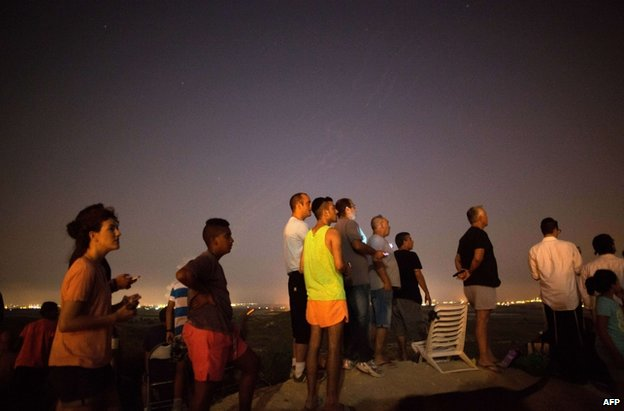 Israelis watch the fighting in Gaza from near Sderot, 12 July