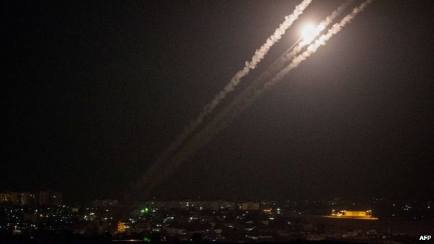 A picture taken from the southern Israeli Gaza border shows rockets being fired from the Gaza strip into Israel, 12 July 2014