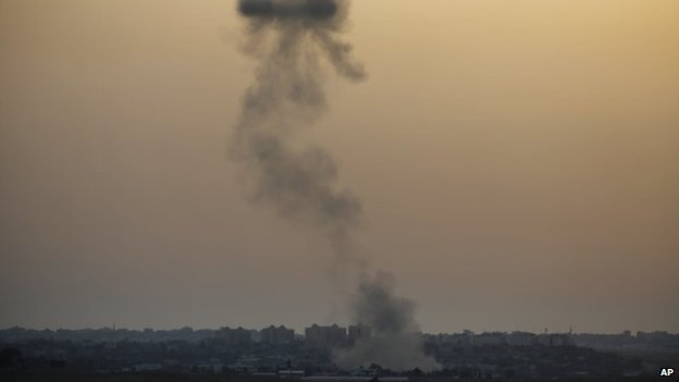 Smoke rises following an Israeli strike on Gaza, seen from the Israel-Gaza border, 12 July 2014