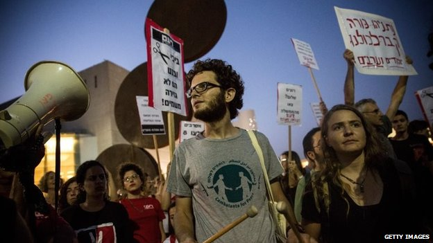 Protesters at a rally held by left-wing demonstrators calling for an end of the Israeli occupation of Palestine and for a ceasefire of the current Israeli-Palestinian conflict, in Tel Aviv, Israel, 12 July 2014