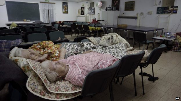 Elderly Israeli women sleep in a bomb shelter in the southern city of Beersheba (12 July