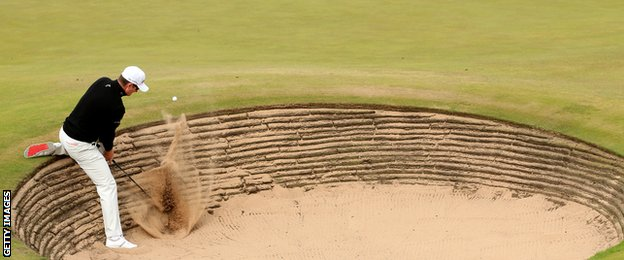 Justin Rose plays a bunker shot at the fifth hole in the Scottish Open third round