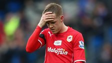 Cardiff City winger Craig Noone holds his head in his hand