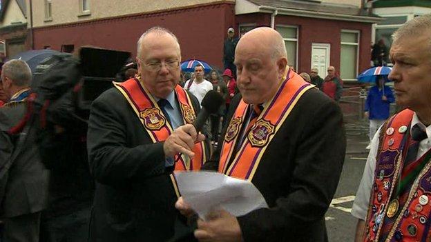 The Orange Order's Belfast deputy county grand master, Spencer Beattie, read a protest speech
