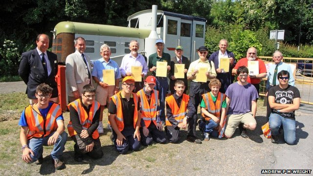 Swanage Railway volunteers with their certificates and members of the railway's Cygnets youth group who have been restoring May - the locomotive which hauled the first passenger trains in 1979