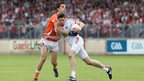 Stephen Harold of Armagh challenges Tyrone captain Sean Cavanagh