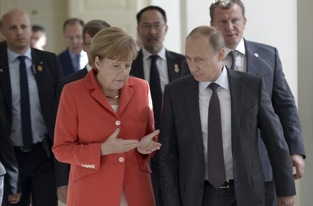 German Chancellor Angela Merkel speaking to Russian President Vladimir Putin in Rio de Janeiro, Brazil, 13 July