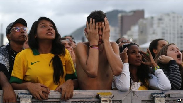 Soccer fans of the Brazil national soccer team watch a live broadcast of the World Cup third-place soccer match between Brazil and Netherlands, inside the FIFA Fan Fest area on Copacabana beach, in Rio de Janeiro, Brazil, 12 July 2014