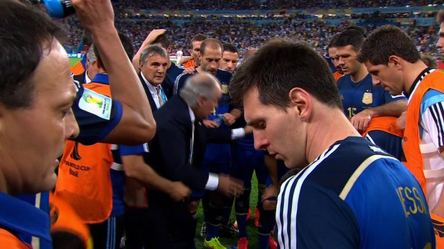 Lionel Messi walks away from the Argentina team talk before the start of extra time during the 2014 World Cup final against Germany