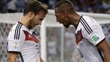 Germany's Mario Gotze, left, celebrates with Jerome Boateng