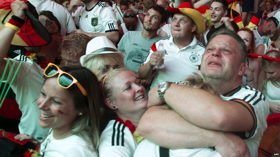 German football fans celebrating their team's goal