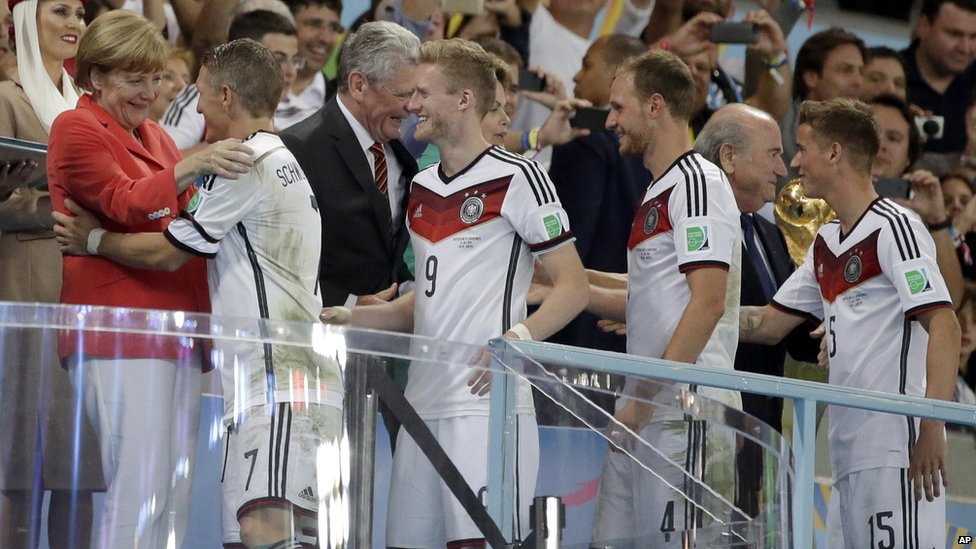 Germany's players being congratulated by Angela Merkel