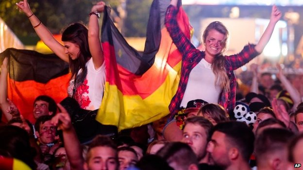 "German fans celebrate their team after Germany won against Argentina by 1-0 at the soccer World Cup final in Rio de Janeiro, Brazil, at a public viewing area called ""Fan Mile"" in Berlin, 13 July 2014"