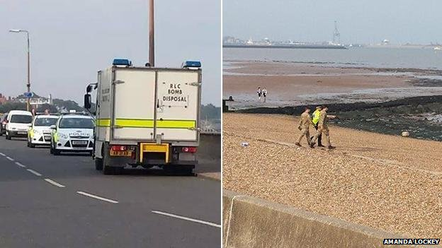 Police and bomb disposal officers on the beach