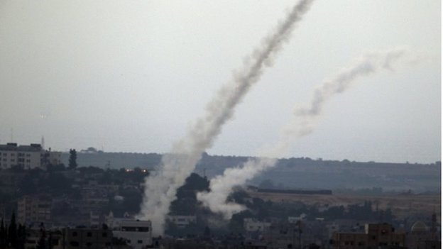 Smoke trails are seen after missiles are fired by Palestinian militants from Gaza City towards southern Israel, as seen from the Israel Gaza border ( picture from 11th July, released 13th July)
