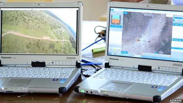 laptops showing aerial map and view from drone